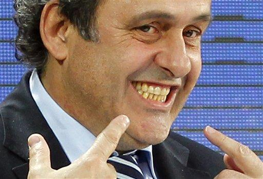 uefa_president_michel_platini_of_france_smiles_to__4d8bfea2cb
